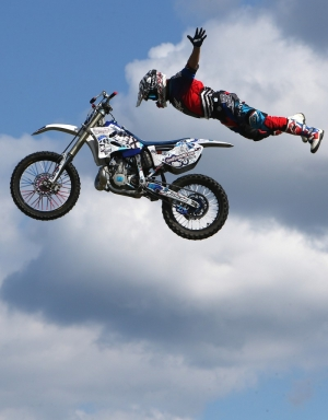 Tim Dyson performs during a motocross stunt show at Frank Brown Park.  ANDREW WARDLOW/The News Herald