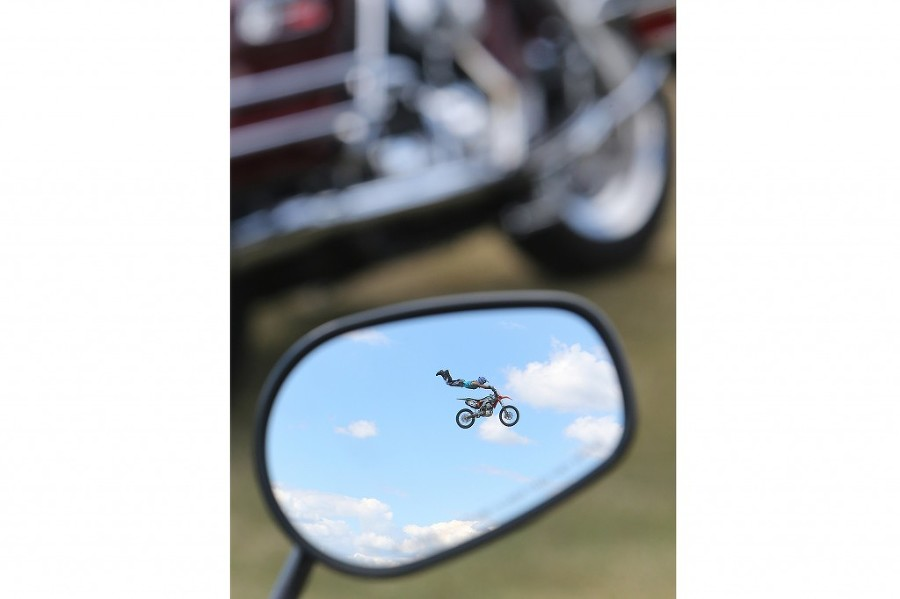 Trevor Cartmill performs during a motocross stunt show at Frank Brown Park. (Panama City Beach Photographer/ANDREW WARDLOW for the News Herald)