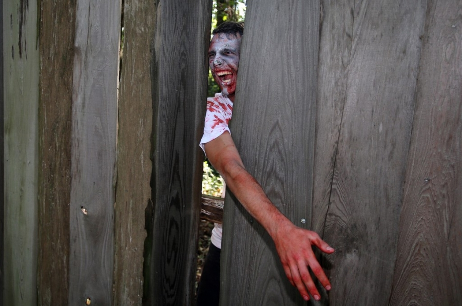 A zombie freaks out runners during third annual Running Scared Zombie 5k Run at Harder