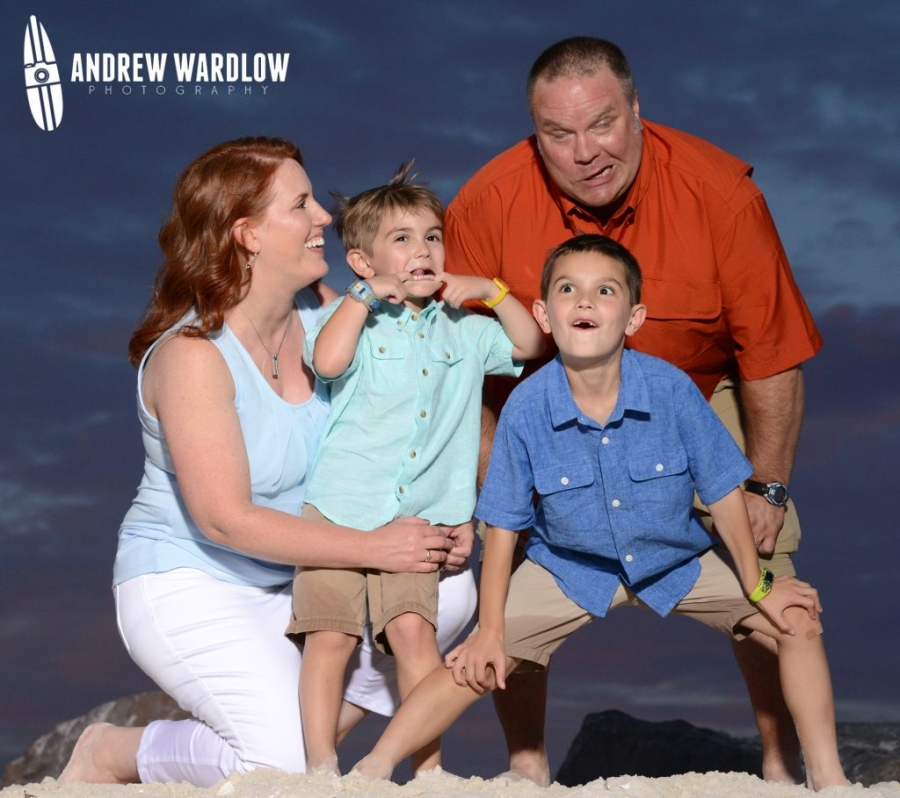 Family making funny faces during a Panama City Beach family photo session with Panama City Beach photographer Andrew Wardlow.