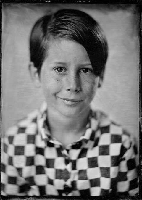 Tintype or wet plate photograph of a young boy.